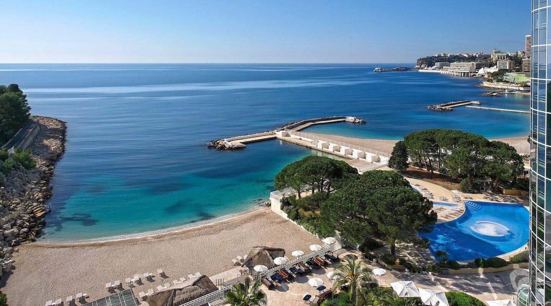 monaco--hotel-beach-and-swimming-pool-min