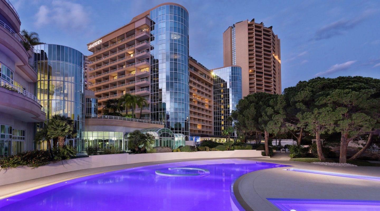 monaco--hotel-outside-pool-night-wiht-lights-min